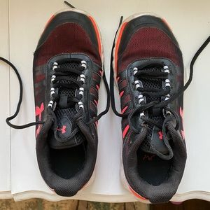 Under Armour running shoes.